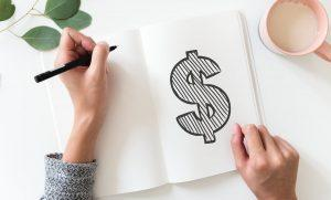 A picture of a dollar sign in a notebook.